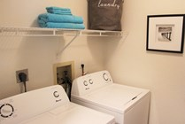 All apartments include laundry rooms with space for storage and a full size washer and dryer.