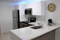 Kitchens peninsulas open up extra counter space for prep or additional seating.